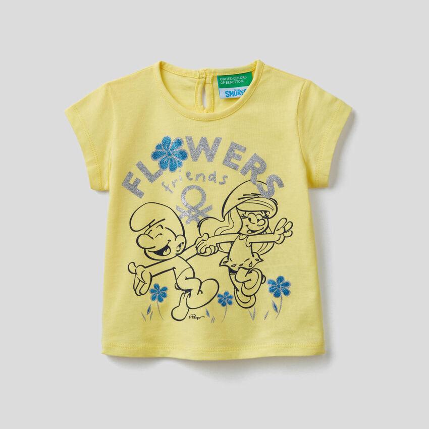 T-shirt jaune avec imprimé Les Schtroumpfs
