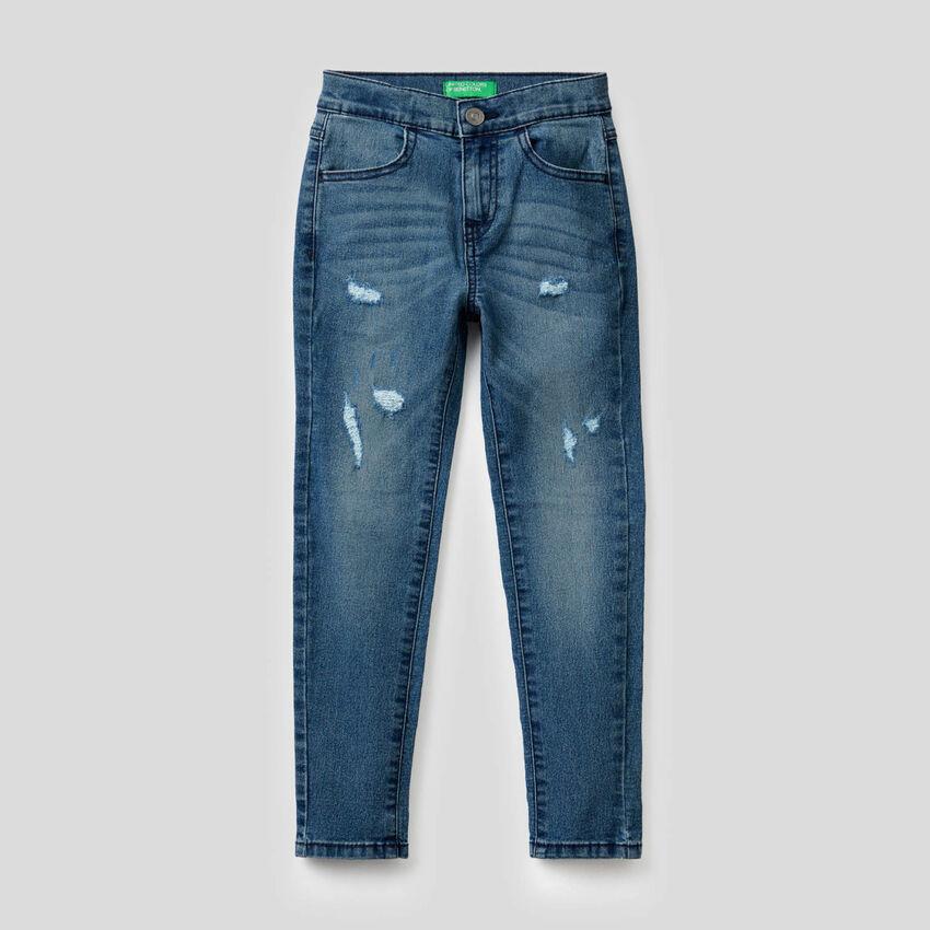 Jeans skinny avec aspect usé
