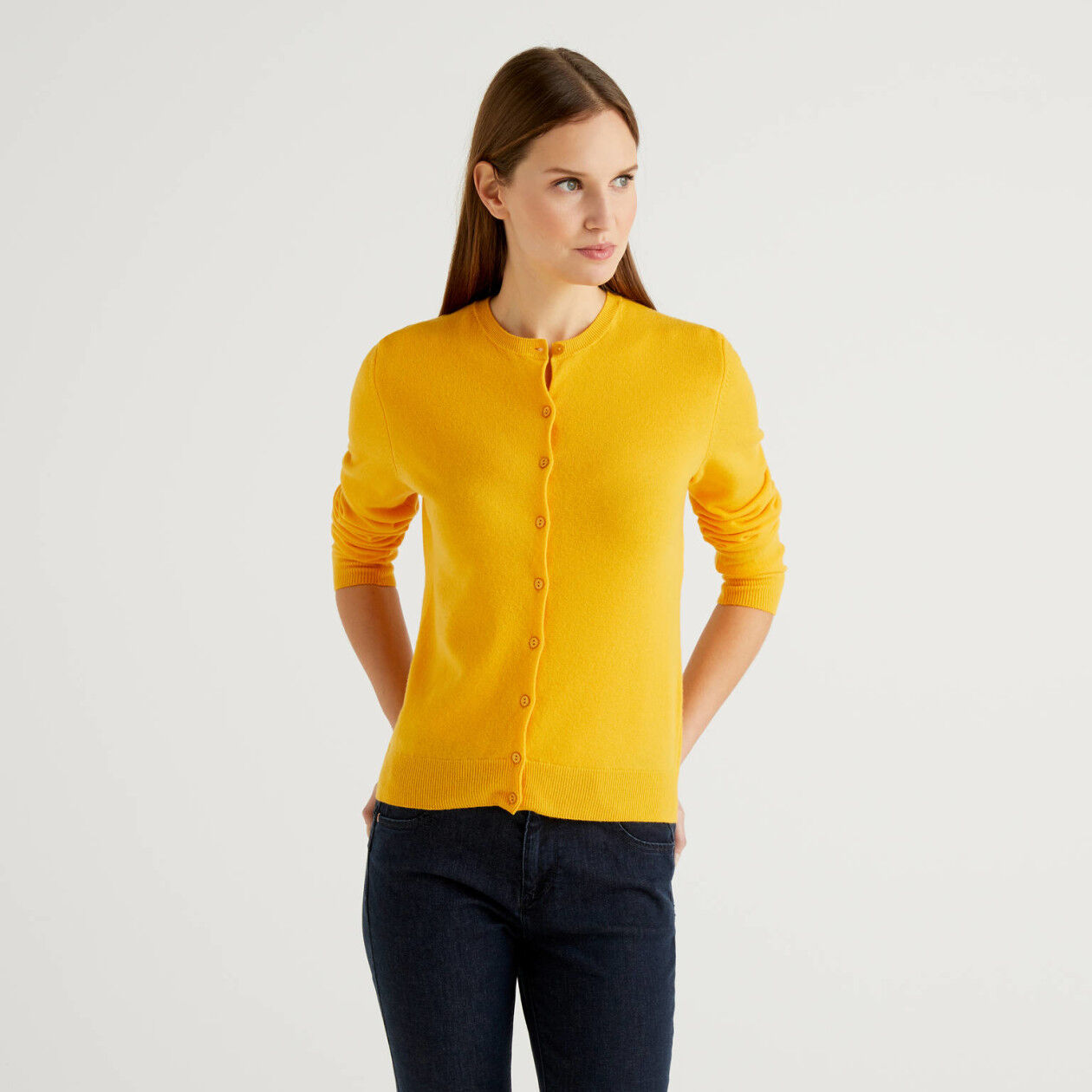 Yellow crew neck cardigan in pure virgin wool