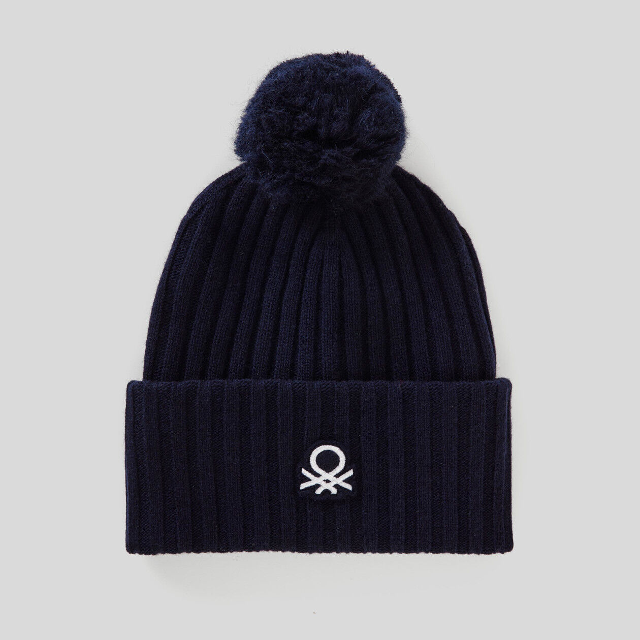 Hat with logo and pom pom