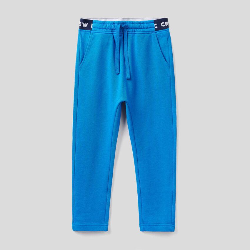 Pantalon en molleton avec élastique décoré du logo