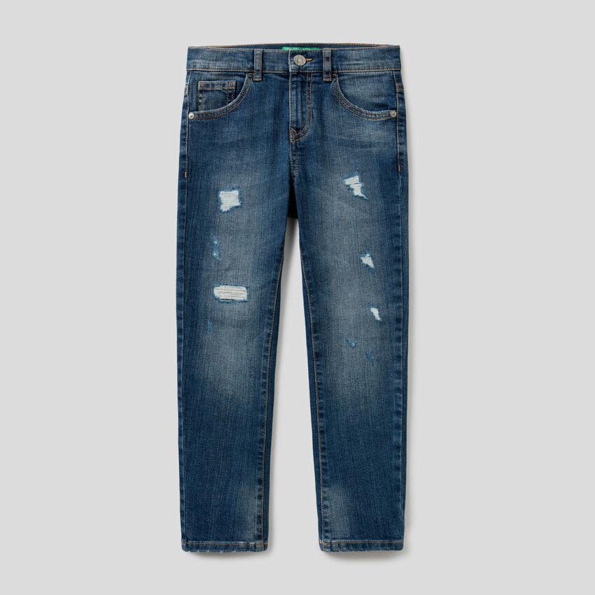 Jeans coupe skinny avec déchirures